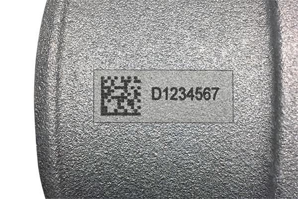 Industrial part marked with human-readable text and 2D barcode