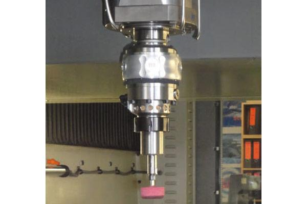 The Biax RSC system mounted in a vertical machining center.