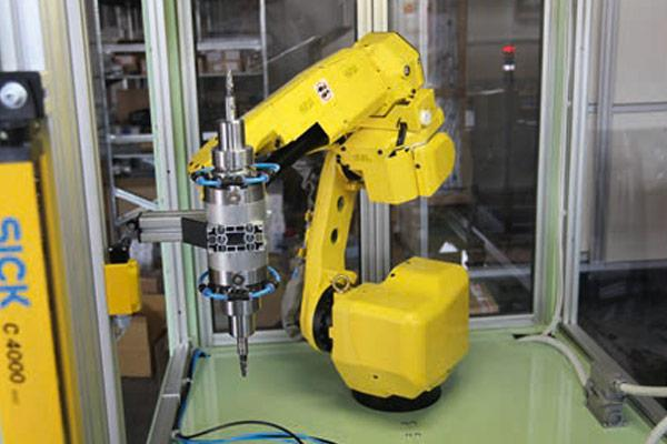 Modular RSC system mounted directly to a robot machining station.